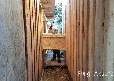 Kwesi building the chute